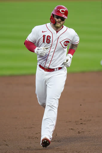 Cincinnati Reds' Tucker Barnhart runs the bases after hitting a home run during the second inning of the team's baseball game against the Pittsburgh Pirates in Cincinnati, Tuesday, Sept. 15, 2020. (AP Photo/Bryan Woolston)