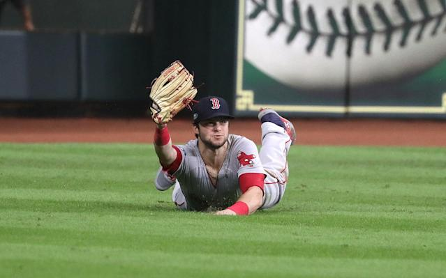 Andrew Benintendi's amazing catch ended a wild ALCS Game 4. (Getty Images)