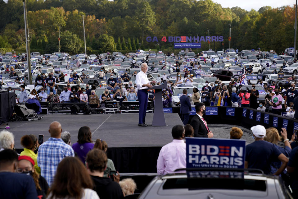Democratic presidential candidate former Vice President Joe Biden speaks at a drive-in rally at Cellairis Amphitheatre in Atlanta, Tuesday, Oct. 27, 2020. (AP Photo/Andrew Harnik)