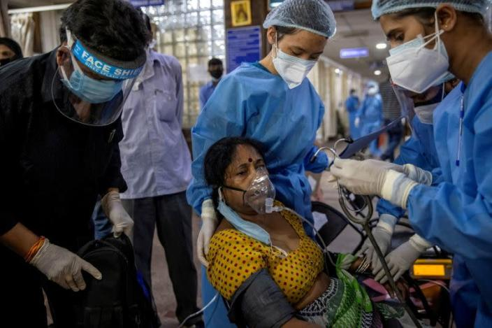 FILE PHOTO: A patient suffering from the coronavirus disease (COVID-19) receives treatment inside the emergency ward at Holy Family hospital in New Delhi