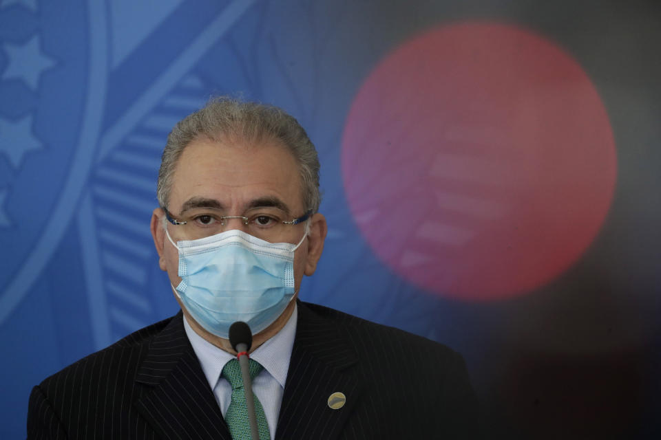 Brazilian Health Minister Marcelo Queiroga attends a press conference to talk about the federal government response to the COVID-19 pandemic at the Planalto presidential palace in Brasilia, Brazil, Wednesday, April 14, 2021. (AP Photo/Eraldo Peres)