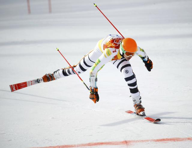 Germany's Stefan Luitz loses his balance after crashing into the last gate and gets disqualified, during the first run of the men's alpine skiing giant slalom event in the Sochi 2014 Winter Olympics at the Rosa Khutor Alpine Center February 19, 2014. REUTERS/Kai Pfaffenbach (RUSSIA - Tags: OLYMPICS SPORT SKIING)