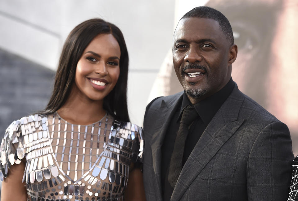 """Cast member Idris Elba, right, and Sabrina Dhowre Elba arrive at the Los Angeles premiere of """"Fast & Furious Presents: Hobbs & Shaw"""" on Saturday, July 13, 2019, at the Dolby Theatre. (Photo by Jordan Strauss/Invision/AP)"""
