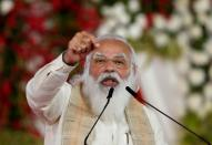 """FILE PHOTO: India's PM Modi addresses a gathering before flagging off the """"Dandi March"""", in Ahmedabad"""