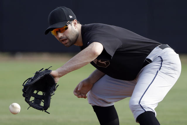 Major League Baseball free agent Neil Walker fields a ground ball during drills Thursday, March 1, 2018, in Bradenton, Fla. (AP Photo/Chris O'Meara)