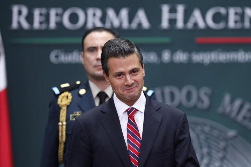 Mexico's President Enrique Pena Nieto smiles during the presentation of the fiscal reform at Los Pinos presidential residence in Mexico City