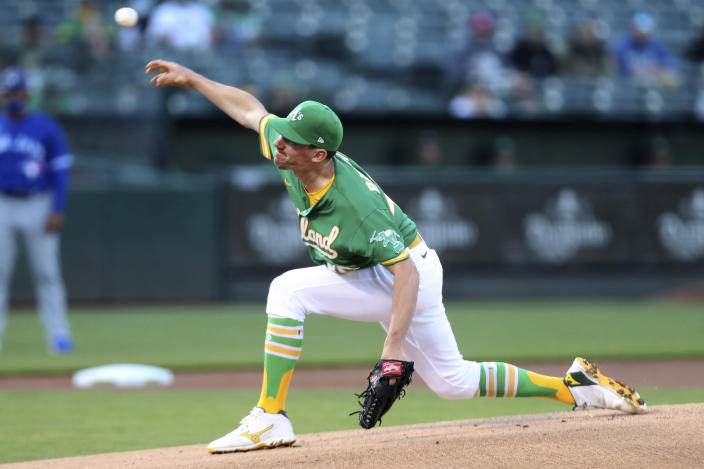 Oakland Athletics' Chris Bassitt throws to a Toronto Blue Jays batter during the first inning of a baseball game in Oakland, Calif., Wednesday, May 5, 2021. (AP Photo/Jed Jacobsohn)