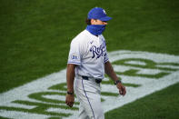 Kansas City Royals manager Mike Matheny walks to the dugout after making a pitching change during the second inning of the team's baseball game against the Chicago White Sox on Saturday, Aug. 1, 2020, in Kansas City, Mo. (AP Photo/Charlie Riedel)