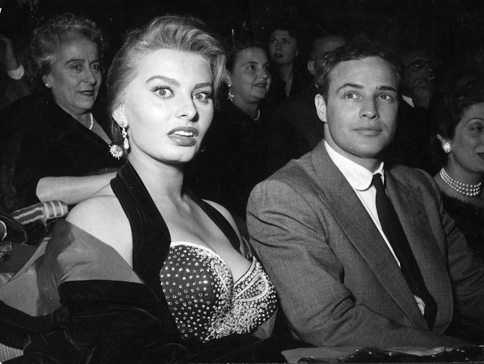 Loren and Marlon Brando at a cinema in Rome in 1954Getty Images