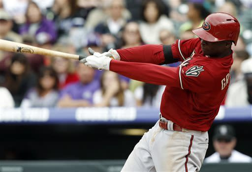 Arizona Diamondbacks' Didi Gregorius follows through with his swing after connecting for a solo home run off Colorado Rockies starting pitcher Juan Nicasio to lead off the fifth inning of a baseball game in Denver, Sunday, April 21, 2013. (AP Photo/David Zalubowski)