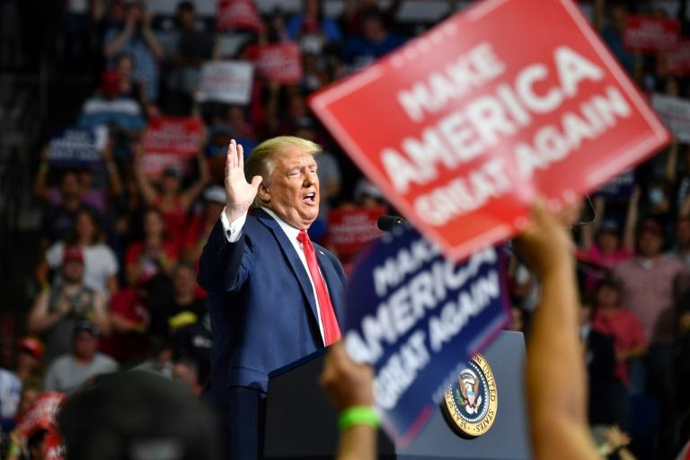 US President Donald Trump defied coronavirus concerns and held a campaign rally -- his first in three months -- in Tulsa, Oklahoma, where the crowd was smaller than promised (AFP Photo/Nicholas Kamm)
