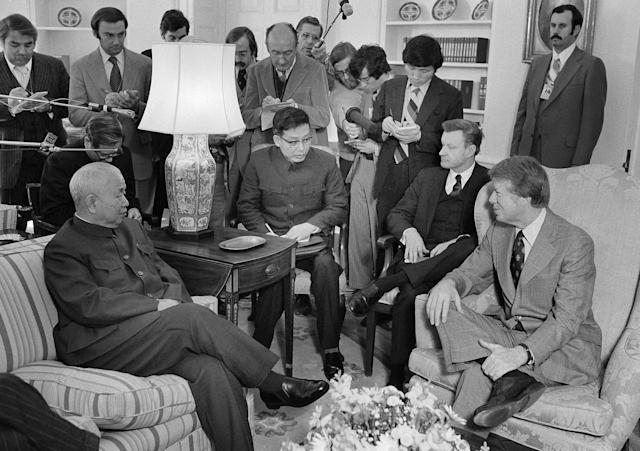 <p>Huang Chen, chief of the liaison office of the People's Republic of China, left, meets with President Jimmy Carter in the Oval Office in Washington, Feb. 8, 1977. From left are Huang; Hsu Shan Wei, an interpreter; Zbigniew Brzezinski, national security advisor, and Carter. In the background are newsmen. (Photo: Harvey Georges/AP) </p>