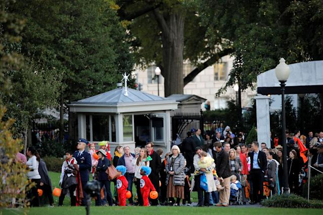 <p>People attend a Halloween event hosted by U.S. President Donald Trump and First Lady Melania Trump at the South Portico of the White House in Washington, D.C. on Oct. 30, 2017. (Photo: Carlos Barria/Reuters) </p>