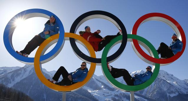 Austrian alpine skiers Georg Streitberger, Klaus Kroell, Max Franz, Joachim Puchner and Romed Baumann (L-R) pose for a photograph in the Olympic rings at the Olympic athletes mountain village in Rosa Khutor near Sochi, February 4, 2014. Sochi will host the 2014 Winter Olympic Games from February 7 to 23. REUTERS/Kai Pfaffenbach (RUSSIA - Tags: SPORT SKIING OLYMPICS)