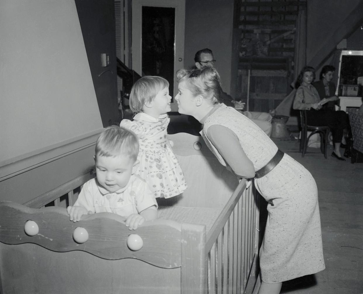 """Debbie Reynolds finds time to play with Carrie on the set of """"Say One for Me."""""""