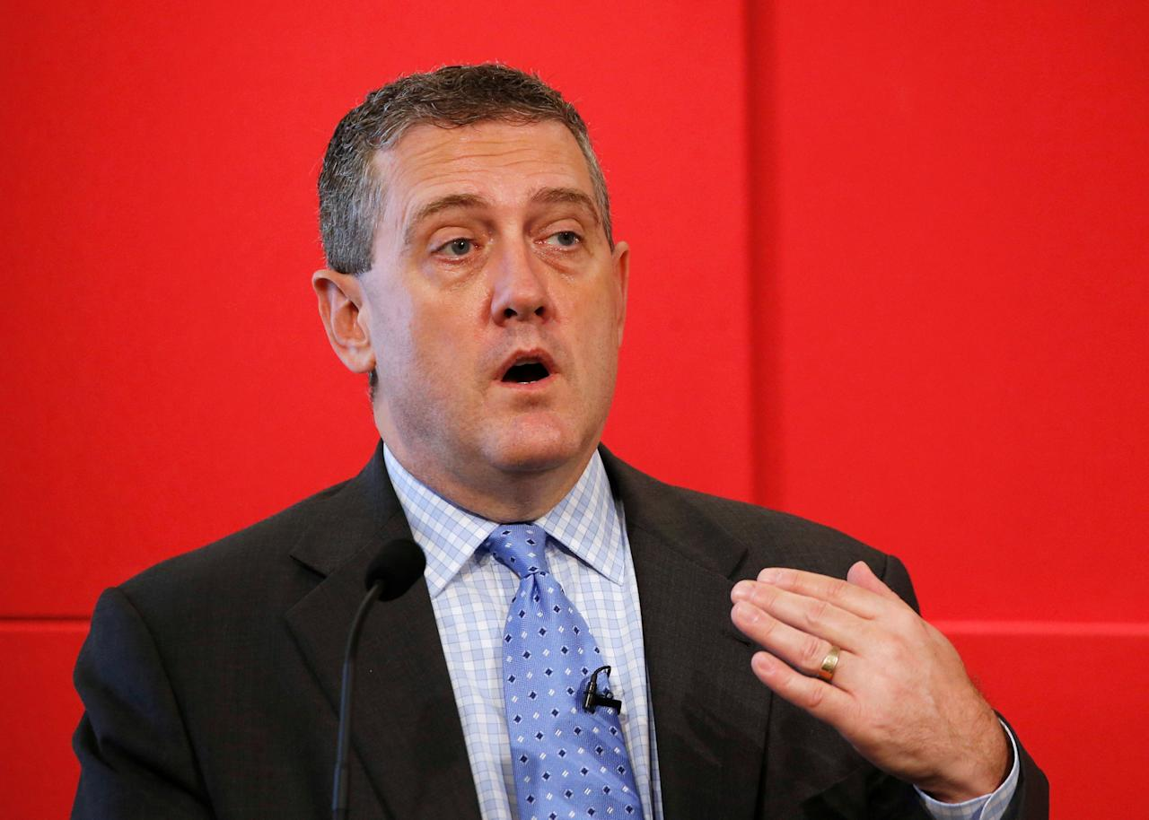 "FILE PHOTO: St. Louis Federal Reserve President James Bullard speaks at a public lecture on ""Slow Normalization or No Normalization"" in Singapore on May 26, 2016. REUTERS/Edgar Su/File Photo"