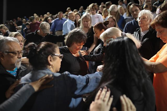 <p>Guests attend a prayer services at the La Vernia High School Football stadium to grieve the 26 victims killed at the First Baptist Church of Sutherland Springs on Nov. 7, 2017 in La Vernia, Texas. (Photo: Scott Olson/Getty Images) </p>