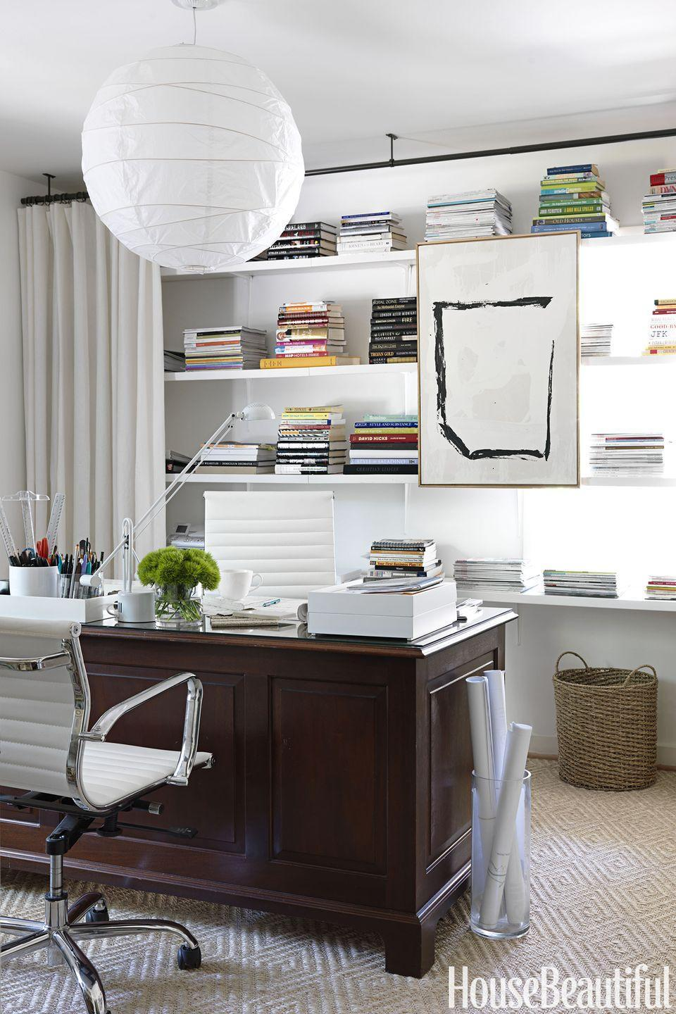 """<p>If your clutter feeds your creativity, you don't have to get rid of it, you just need to conceal it smartly. In a<a href=""""https://www.housebeautiful.com/design-inspiration/home-makeovers/tips/g960/modern-home-decorating-ideas-1010/"""" rel=""""nofollow noopener"""" target=""""_blank"""" data-ylk=""""slk:Birmingham, Alabama"""" class=""""link rapid-noclick-resp""""> Birmingham, Alabama</a> office, curtains soften the room and hide everyday office papers and books that are stacked up on the shelves.</p>"""