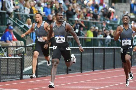 Jul 8, 2016; Eugene, OR, USA; Wallace Spearmon (left) and Justin Gatlin (middle) and Isiah Young (right) compete during the men's 200m semifinals in the 2016 U.S. Olympic track and field team trials at Hayward Field. Mandatory Credit: James Lang-USA TODAY Sports