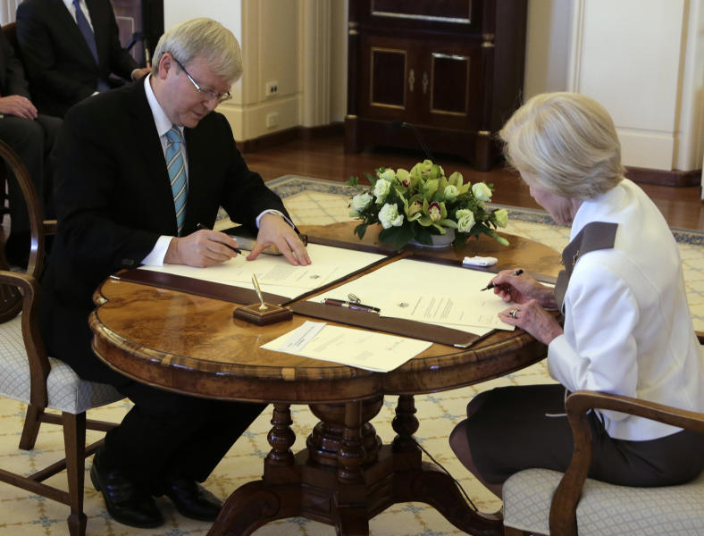 Governor-General Quentin Bryce, right, commissions Kevin Rudd with in half an hour of Parliament resuming for what is likely to be its last day before elections, in Canberra, Australia, Thursday, June 27, 2013. Rudd is sworn in as Australian prime minister three years and three days after he was ousted from the same job in an internal government showdown. (AP Photo/Rick Rycroft)