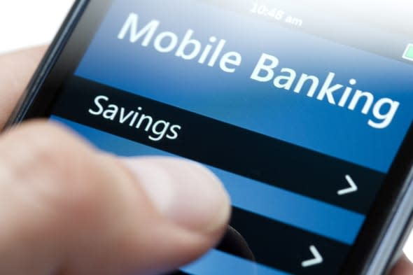 Extreme close-up of hand holding a modern smartphone with a generic mobile banking app running.This is a version without amounts