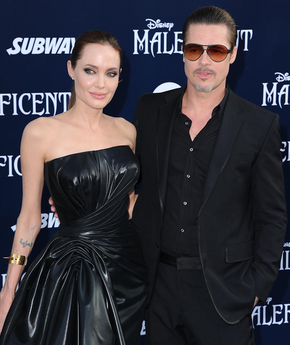 """HOLLYWOOD, CA - MAY 28:  Angelina Jolie and Brad Pitt arrives at the World Premiere Of Disney's """"Maleficent"""" at the El Capitan Theatre on May 28, 2014 in Hollywood, California.  (Photo by Steve Granitz/WireImage)"""