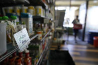 A gluten free section at Porchlight Community Service food pantry is seen Thursday, May 6, 2021, in San Diego. For millions of Americans with food allergies or intolerances, the pandemic has created a particular crisis: Most food banks and government programs offer limited options. (AP Photo/Gregory Bull)