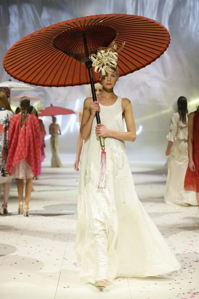 A model showcases designs by Akira on the catwalk as part of Mercedes Benz Fashion Festival Sydney 2012 at Sydney Town Hall on August 21, 2012 in Sydney, Australia. (Photo by Matt King/Getty Images)