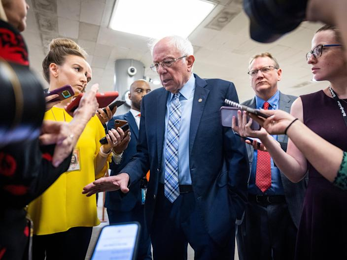 Reporters interview Independent Senator from Vermont Bernie Sanders on his way to the Senate Chamber for a vote in the US Capitol in Washington DC, USA, 16 June 2021.  (EPA)
