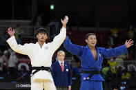 THIS CORRECTS TO GOLD, NOT BRONZE - Yang Yung-wei of Taiwan, left, and Naohisa Takato of Japan react after competing in their men's -60kg gold medal judo match at the 2020 Summer Olympics, Saturday, July 24, 2021, in Tokyo, Japan. (AP Photo/Vincent Thian)