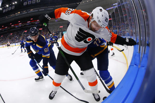Philadelphia Flyers forward James van Riemsdyk (25) fights for control of the puck against St. Louis Blues forward Jacob De La Rose (61) of Sweden during the first period of an NHL hockey game Wednesday, Jan. 15, 2020 in St. Louis. (AP Photo/Dilip Vishwanat)