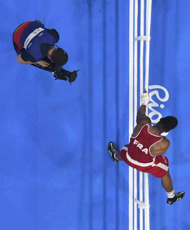 2016 Rio Olympics - Boxing - Final - Men's Super Heavy (+91kg) Final Bout 273 - Riocentro - Pavilion 6 - Rio de Janeiro, Brazil - 21/08/2016. Tony Yoka (FRA) of France climbs over the ropes. REUTERS/Pool FOR EDITORIAL USE ONLY. NOT FOR SALE FOR MARKETING OR ADVERTISING CAMPAIGNS.