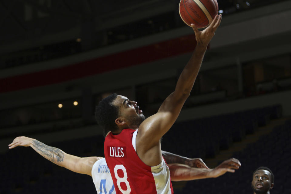 Canada's Trey Lyles drives to the net during the first half of a FIBA men's Olympic qualifying basketball game against Greece Tuesday, June 29, 2021 at Memorial Arena in Victoria, British Columbia. (Chad Hipolito/The Canadian Press via AP)