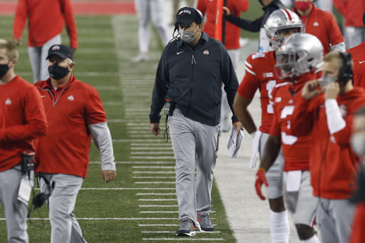 Ohio State coach Ryan Day watches during the second half of the team's NCAA college football game against Rutgers on Saturday, Nov. 7, 2020, in Columbus, Ohio. Ohio State won 49-27. (AP Photo/Jay LaPrete)