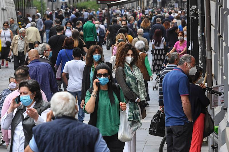 NAPLES, CAMPANIA, ITALY - 2020/05/19: A crowd of people wearing protective masks walk in Naples center. Italy begins a staged end to a nationwide lockdown due to the spread of the coronavirus disease, allowing the re-opening of all activities except schools and the mobility of citizens. (Photo by Salvatore Laporta/KONTROLAB/LightRocket via Getty Images) (Photo: KONTROLAB via Getty Images)