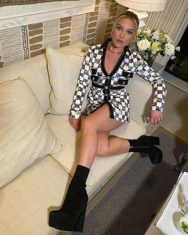 """<p>After a pandemic-induced hiatus, Florence Pugh is back in the business of promoting her next film Black Widow. </p><p>For her return to press events, the 25-year-old wore a super 1970s look, pairing a checkerboard mini by Giambattista Valli with super high black suede platform boots. </p><p><a href=""""https://www.instagram.com/p/CPGfq8qpP_j/"""" rel=""""nofollow noopener"""" target=""""_blank"""" data-ylk=""""slk:See the original post on Instagram"""" class=""""link rapid-noclick-resp"""">See the original post on Instagram</a></p>"""