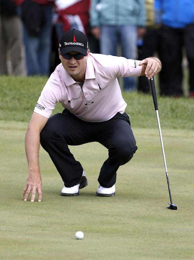 Zach Johnson lines up his putt on the 13th hole during the final round of the BMW Championship golf tournament at Conway Farms Golf Club, Monday, Sept. 16, 2013, in Lake Forest, Ill. (AP Photo/Charles Rex Arbogast)