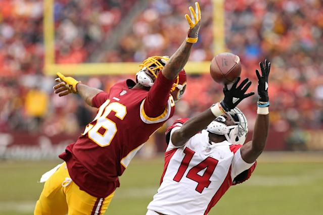 <p>Arizona Cardinals wide receiver J.J. Nelson (14) attempts to make a catch as Washington Redskins cornerback Bashaud Breeland (26) defends in the fourth quarter at FedEx Field. The Redskins won 20-15. Mandatory Credit: Geoff Burke-USA TODAY Sports </p>