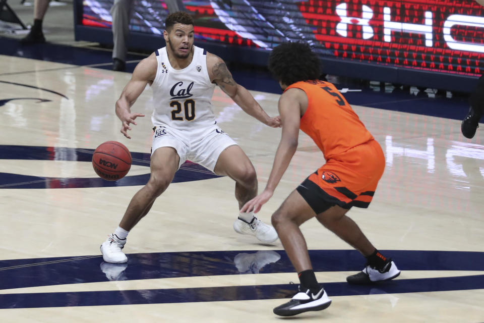 California forward Matt Bradley loses possession of the ball on the final play, as Oregon State guard Ethan Thompson defends during an NCAA college basketball game in Berkeley, Calif., Thursday, Feb. 25, 2021. (AP Photo/Jed Jacobsohn)