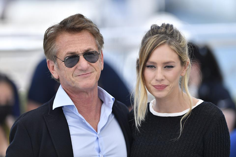 CANNES, FRANCE - JULY 11: US actor and director Sean Penn (L) and US actress Dylan Penn (R) pose during a photocall for the film