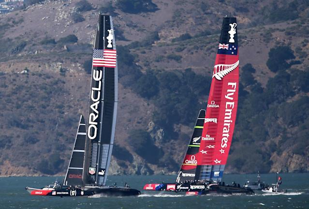 SAN FRANCISCO, CA - SEPTEMBER 24: Oracle Team USA skippered by James Spithill sails ahead of Emirates Team New Zealand skippered by Dean Barker during race 18 of the America's Cup Finals on September 24, 2013 in San Francisco, California. Team USA swept two races today against Team New Zealand to tie the series at 8, settiing up a winner-take-all race tomorrow. (Photo by Jed Jacobsohn/Getty Images)