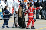 Italian Red Cross officials help immigrants as they arrive on April 15, 2015 in the Italian port of Messina in Sicily (AFP Photo/Giovanni Isolino)
