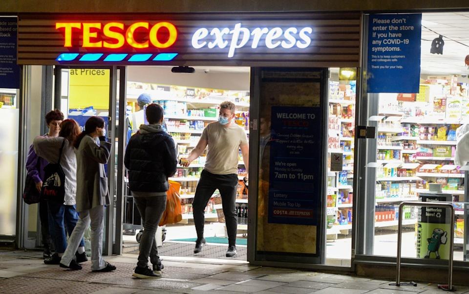 People are seen at Tesco Express on October 12, 2020  - Finbarr Webster/Getty Images
