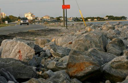 Boulders protect a section of Highway 98 on the Gulf Coast in Alligator Point, Florida, July 9, 2014. REUTERS/Phil Sears