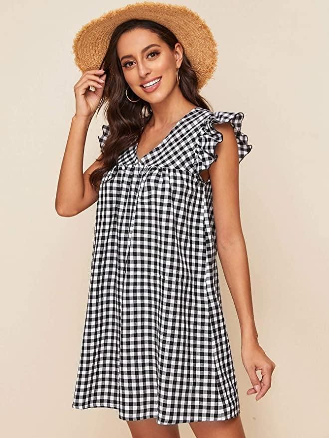 <p>This <span>Romwe V Neck Ruffle Dress</span> ($25) makes us want to go to the beach. You?</p>