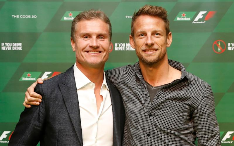 Former Formula One driver David Coulthard and McLaren Honda F1 driver Jenson Button at the Official F1 Heineken Party after the Canadian Grand Prix - Getty Images North America