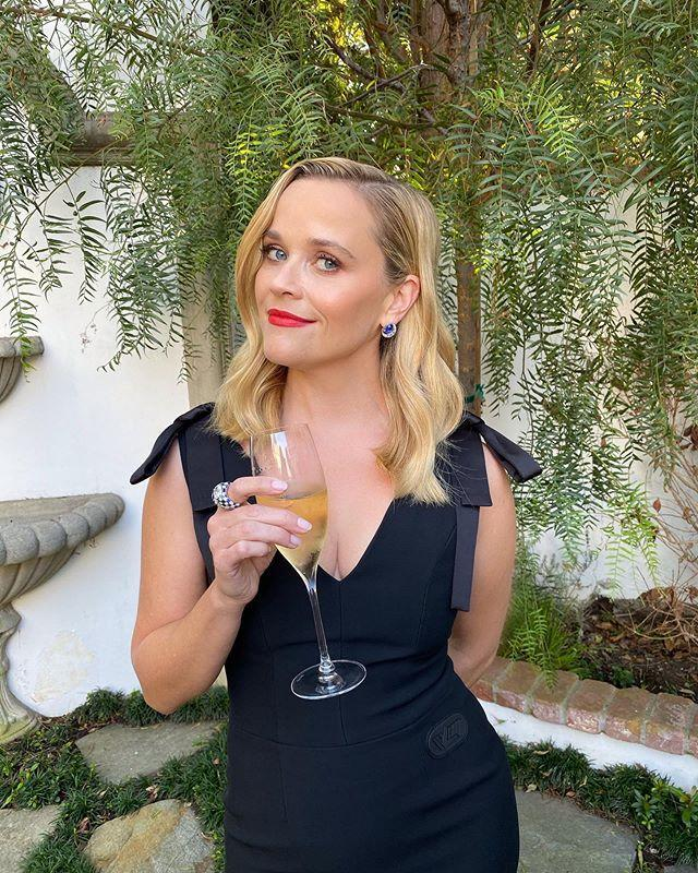 "<p><em>Little Fires Everywhere</em> and <em>The Morning Show</em> star and producer Reese Witherspoon kept her look sleek, chic, sexy and just a little party-frivolous in a body-con black Louis Vuitton dress with unexpected bow details at the shoulders.</p><p><a href=""https://www.instagram.com/p/CFYMEICA5wP/?utm_source=ig_embed"" rel=""nofollow noopener"" target=""_blank"" data-ylk=""slk:See the original post on Instagram"" class=""link rapid-noclick-resp"">See the original post on Instagram</a></p>"