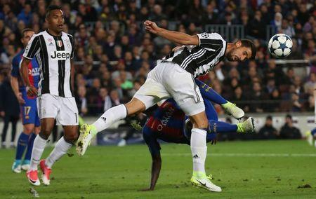 Football Soccer - FC Barcelona v Juventus - UEFA Champions League Quarter Final Second Leg - The Nou Camp, Barcelona, Spain - 19/4/17 Juventus' Sami Khedira heads clear of Barcelona's Samuel Umtiti Reuters / Sergio Perez Livepic