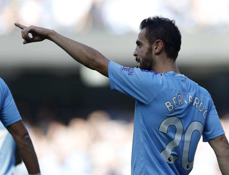 Manchester City's Bernardo Silva celebrates after scoring his sides fifth goal during the English Premier League soccer match between Manchester City and Watford at Etihad stadium in Manchester, England, Saturday, Sept. 21, 2019. (AP Photo/Rui Vieira)