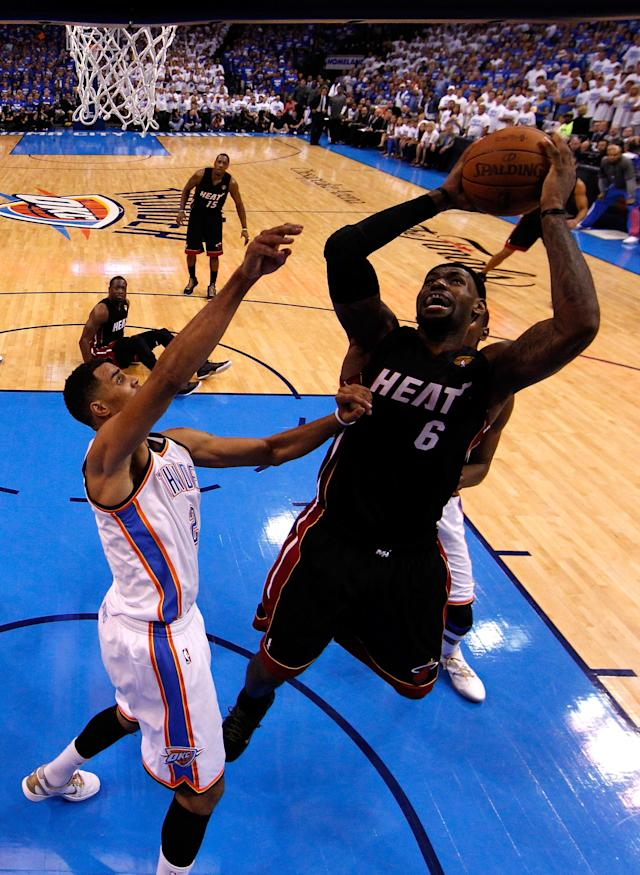 OKLAHOMA CITY, OK - JUNE 14: LeBron James #6 of the Miami HGeat oes up for a shot over Thabo Sefolosha #2 of the Oklahoma City Thunder in the second half in Game Two of the 2012 NBA Finals at Chesapeake Energy Arena on June 14, 2012 in Oklahoma City, Oklahoma. NOTE TO USER: User expressly acknowledges and agrees that, by downloading and or using this photograph, User is consenting to the terms and conditions of the Getty Images License Agreement. (Photo by Jim Young/Pool/Getty Images)